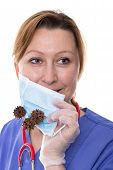 image of mrsa  - Doctor holding up a surgical mask in front of her mouth - JPG