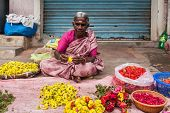 TIRUCHIRAPALLI, INDIA - FEBRUARY 14, 2013: Unidentified Indian woman - hawker (street vendor) of flo