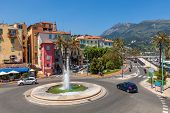 MENTON, FRANCE - JUNE 13, 2013: Roundabout with fountain in Menton - small town situated on French R