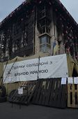 KIEV, UKRAINE - APR 7, 2014: Polish support Putsch of Junta in Kiev Burned  Kiev with poster - Polan