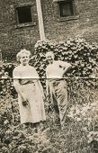 POLAND, CIRCA 1950's: Vintage photo of happy couple in garden