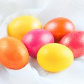 colorful easter eggs on the white napkin