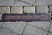 foto of cold-war  - Detail of a street floor sign in Berlin remembering the Berlin wall - JPG