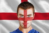 Composite image of serious young england fan with facepaint against digitally generated english nati