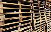 picture of wooden pallet  - Wooden transport pallets in stacks - JPG