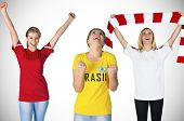Composite image of football fans against white background with vignette