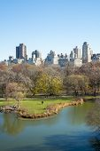 NEW YORK, US - NOVEMBER 23: Manhattan skyline with Central Park lake in the foreground in Autumn. No