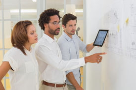 picture of half-dressed  - Concentrated business people using digital tablet in meeting at the office - JPG