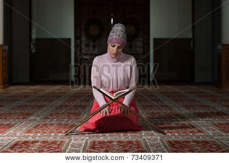 Muslim Woman Is Reading The Koran