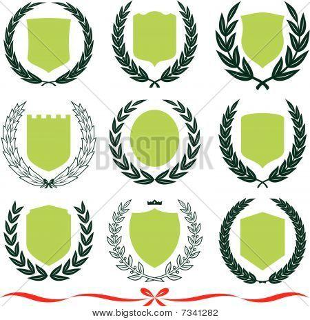 Vector shields and laurel wreaths set