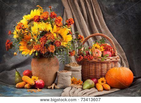 Autumn still life. Flower, fruit and vegetables