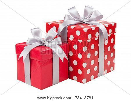 Red boxes gifts tied with gray bows isolated on white