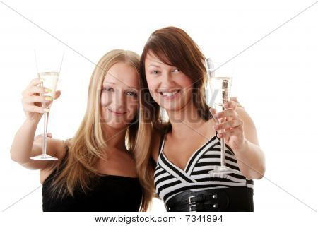 Two Casual Young Women Enjoying Champagne