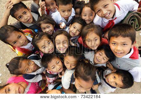 SAYABOURY, LAOS, FEBRUARY 16, 2012: group of joyful unidentified kids posing during the Elefantasia festival on February 16, 2012 in Sayaboury, Laos