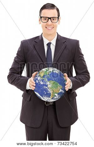 Young businessman holding the world isolated on white background, earth image in public domain and furnished by NASA