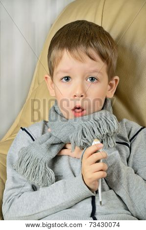 Sick Boy Coughing And Holding A Thermometer