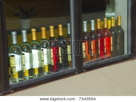 Bottles on a window pane.