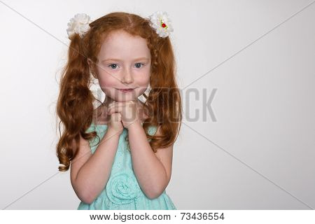 Little redhead fashionista in a  summer dress. Six years.