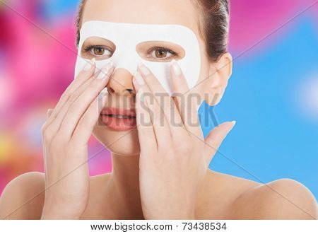 Young beautiful woman with collagen eye mask.