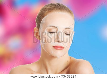 Beautiful woman with collagen mask on face