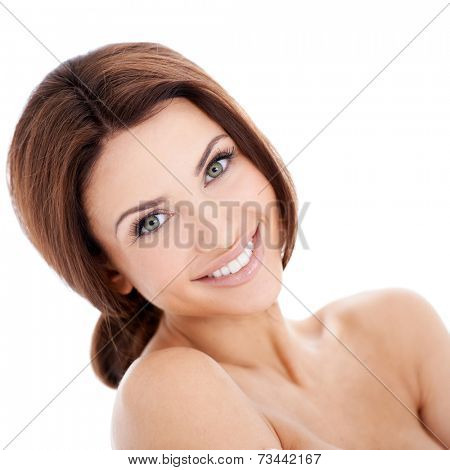 Close Up Portrait of Smiling Brunette Woman with Bare Shoulders in Studio