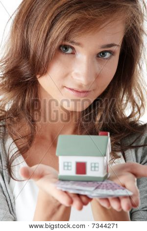 Young Woman Holding Euros Bills And House Model