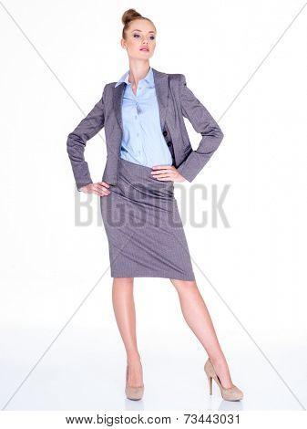 Businesswoman Standing with Hands on Hips in Studio Looking Severe and Intimidating