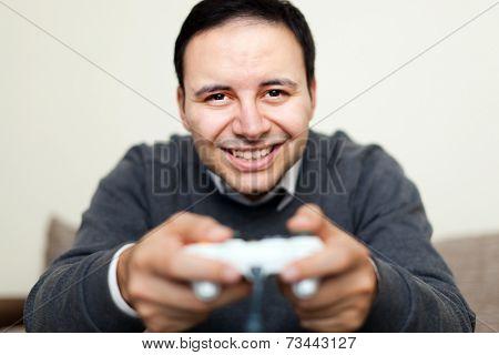 Man playing videogames on his sofa