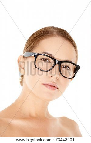 Portrait of Young Woman with Hair Pulled Back Wearing Eyeglasses in Studio