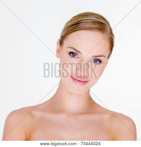 Head and Shoulders Portrait of Smiling Blond Woman with Bare Shoulders in Studio