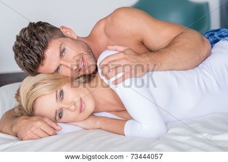 Close up Very Sweet Middle Age Lovers Lying on Bed Looking at Camera