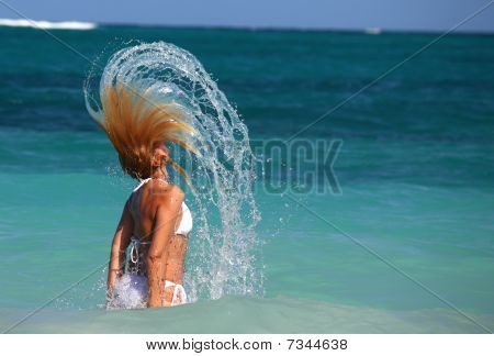 Woman Flips Hair In Turquoise Waters