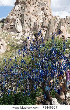 Evil eye in tree behind Uchisar Castle in Cappadocia