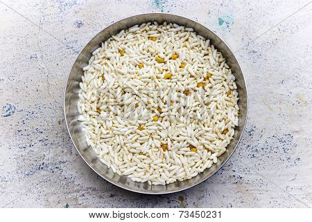A plate filled with puffed rice grains or pori on an isolated background