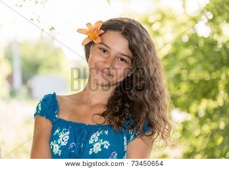 Teen Girl With Curly Dark Hair On  Nature