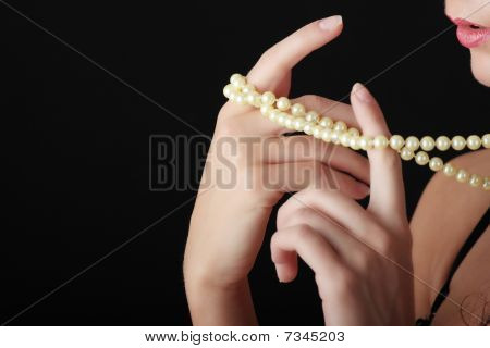 Woman With A Pearl Necklace