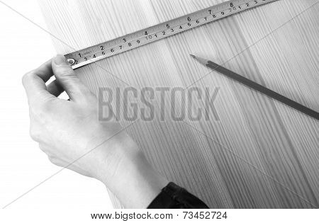 Using A Steel Tape Measure On A Wooden Board