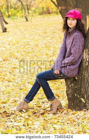 Young Beautiful Woman In Autumn City Park