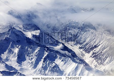 Top View On Snow Mountains And Glacier In Mist