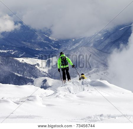 Freeriders On Off-piste Slope And Mountains In Haze