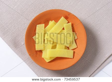 bowl of sliced bamboo shoots on place mat