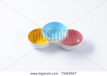 overhead view of three colorful bowls formed into pyramid
