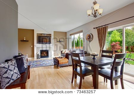 American House Interior With Open Floor Plan. Dining Room With Exit To Backyard