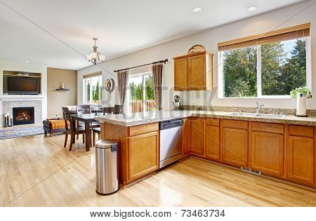 Kitchen Room With Granite Tops And Honey Tone Cabinets