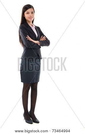 Portrait of pan Asian business woman smiling, full length standing isolated on white background.