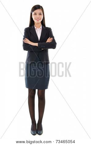 Portrait of beautiful pan Asian business woman smiling, full length standing isolated on white background.