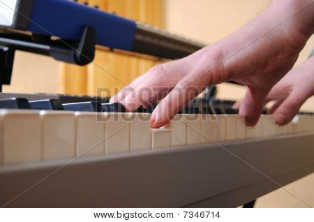 Man Playing Synthesizer