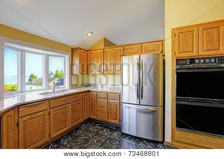Kitchen Room With Granite Tops And Black Tile Floor