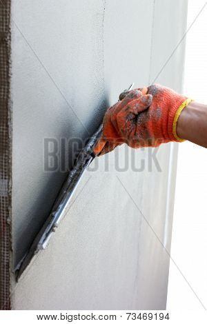 Hand Putties A Wall By Putty Knife For Facade