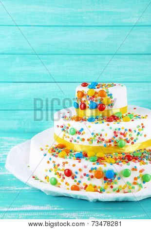 Beautiful tasty birthday cake on color wooden background